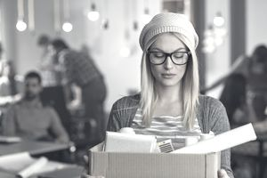 woman with box leaving desk