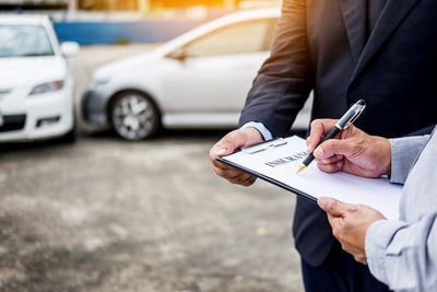 Signing a car insurance form