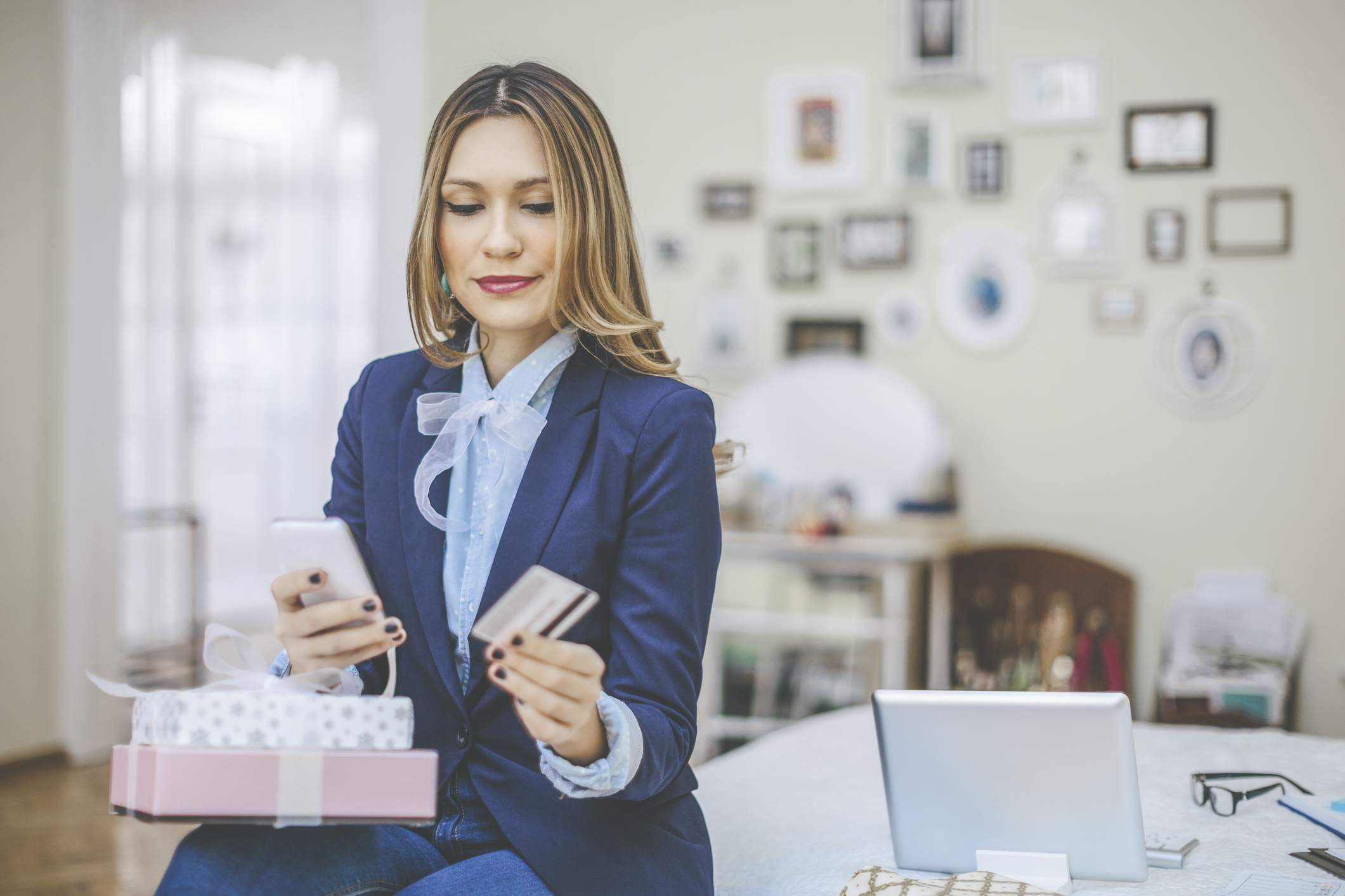 Woman checking her credit card balance to build good credit