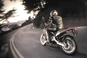 Motorcyclist rounding a curve