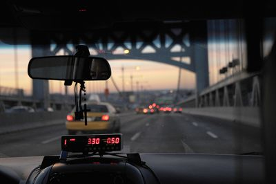 Dashboard view from a taxi crossing the Queensboro Bridge amongst other insured drivers in Queens, NY