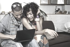 Couple looking over financial information on a computer