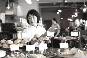 Senior woman working at bakery