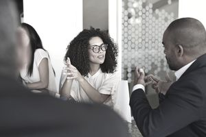 Executives hold a discussion in a boardroom