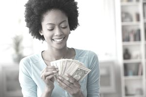 Woman smiling as she counts money