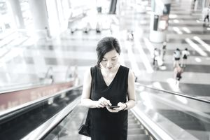 Woman Checking Stocks on Phone