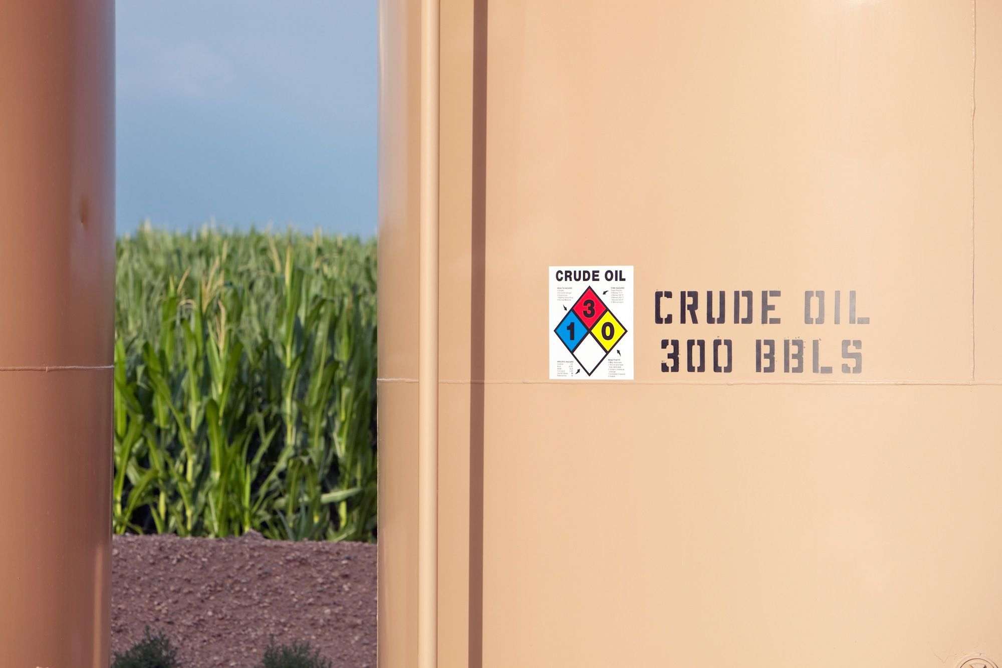 Crude Oil Tank Portions with Corn Background