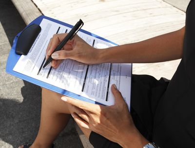 Woman filling out mortgage application