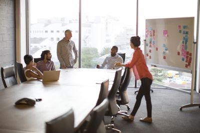 Employees discuss business in a conference room