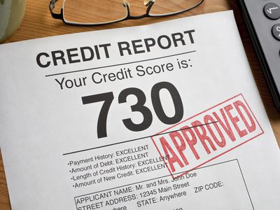 Credit report with a score of 730 stamped