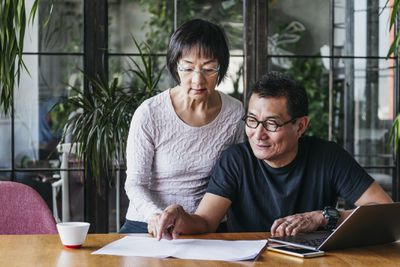 Senior couple going through paperwork together