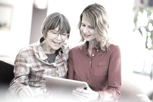 Two women discussing potential life insurance beneficiaries