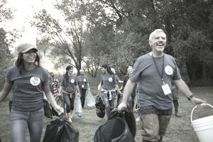 People volunteering, cleaning up garbage in park