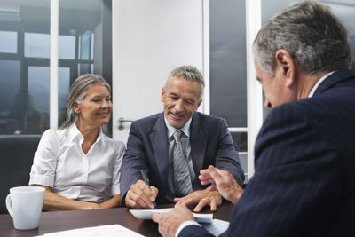 Mature couple planning retirement with their advisor