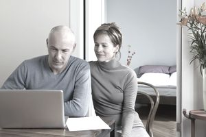 A couple using a laptop together