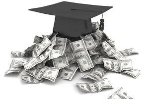a graduation cap sitting on top of loose hundred dollar bills