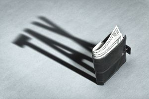 Tax in shadow of money in wallet