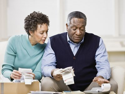 Mature couple reviewing receipts for income taxes