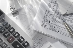 Closeup of a tax return, a pen, and a calculator
