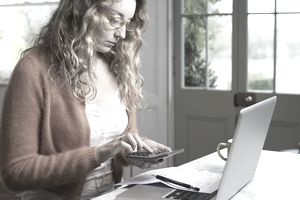 Woman paying bills on laptop