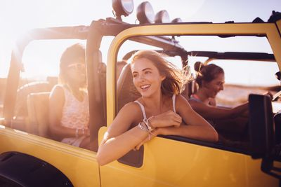 Group of teens in a car on a road trip