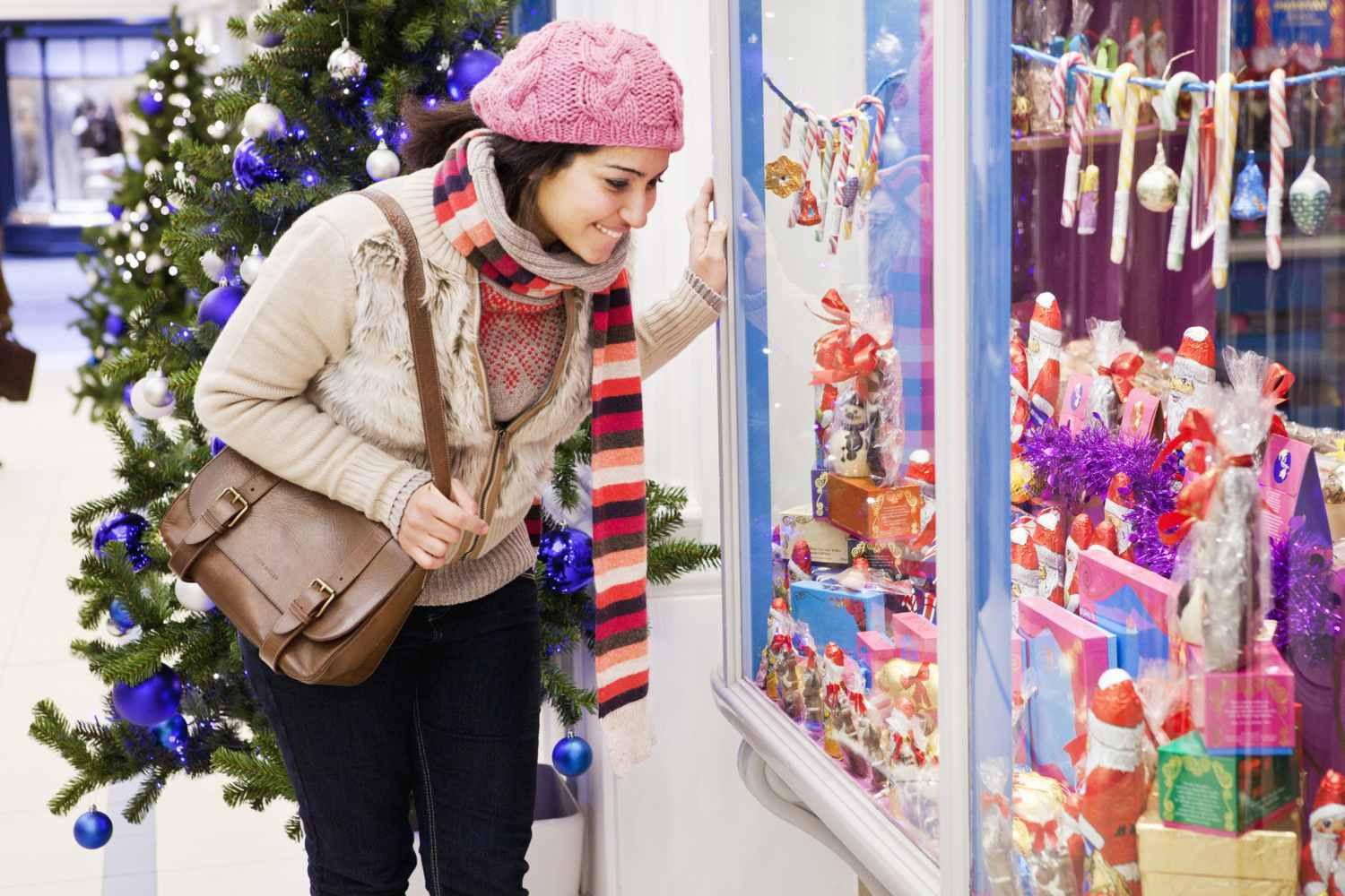 Woman window shopping during the holiday season