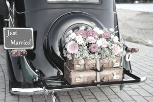 A car decorated with flowers and a Just Married sign