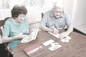 Senior Couple Clipping Coupons