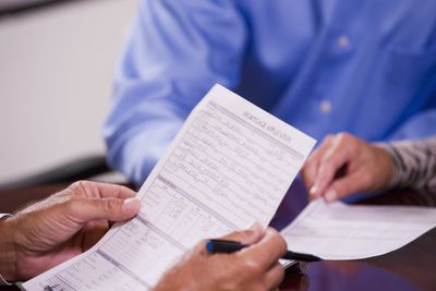 Close up of man filling out a mortgage application