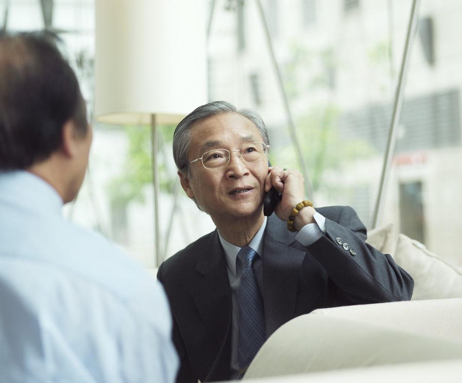 Asian man on telephone