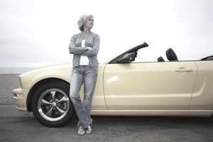 Woman Next to Yellow Sports Car