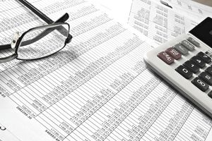 Glasses and calculator on spreadsheet