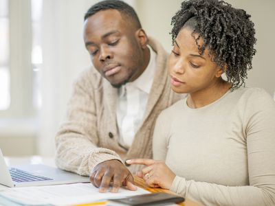 A husband and wife looking at their finances.