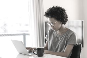A college student looks over her loan options for the upcoming school year.