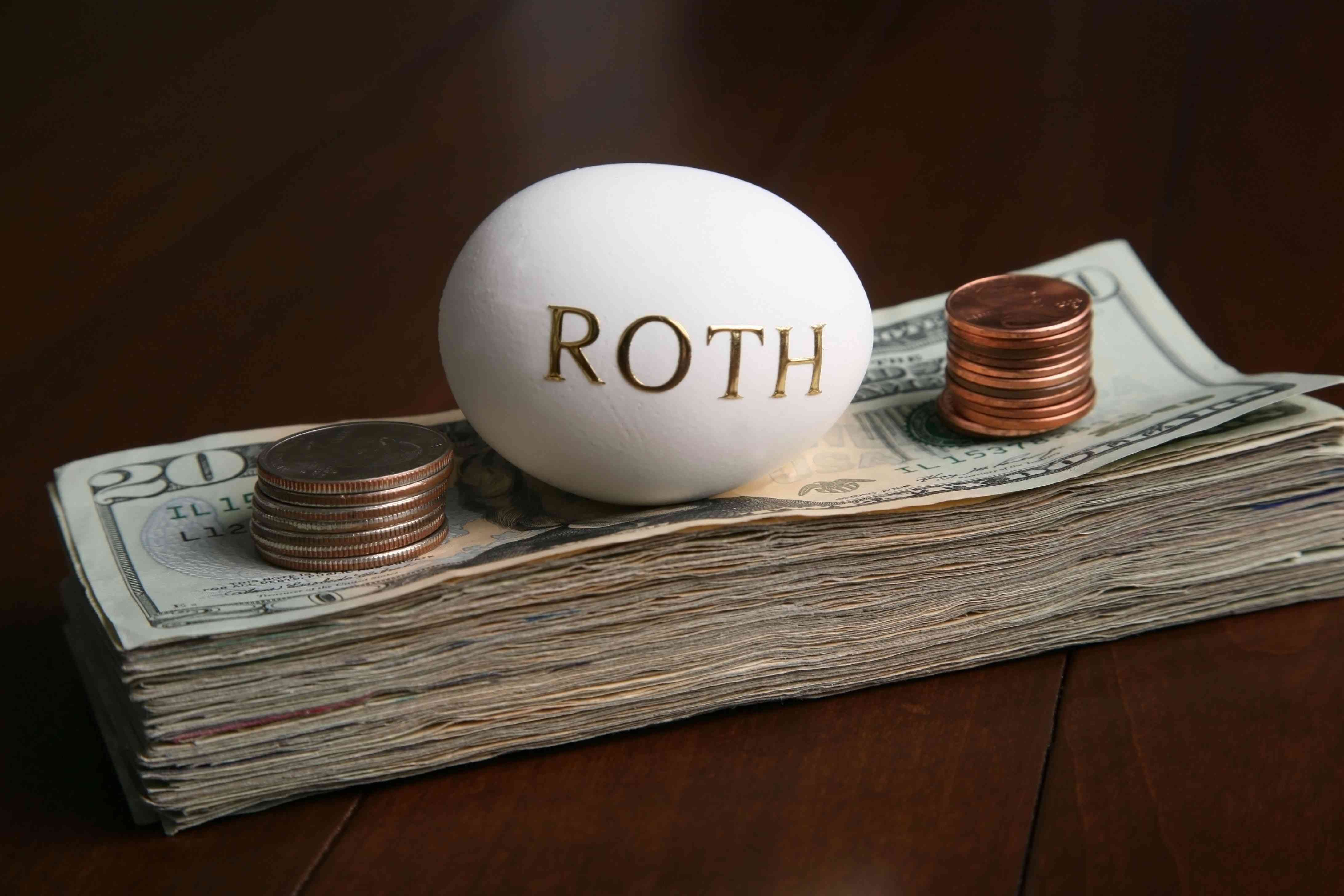 Egg on pile of money with Roth written on it