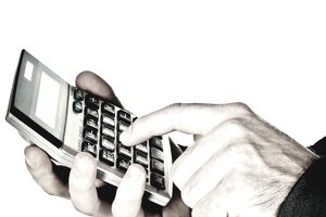 a man's hands holding a calculator