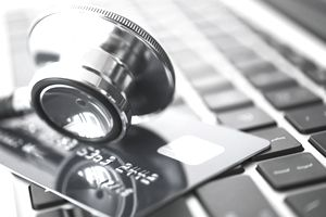 stethoscope and credit card