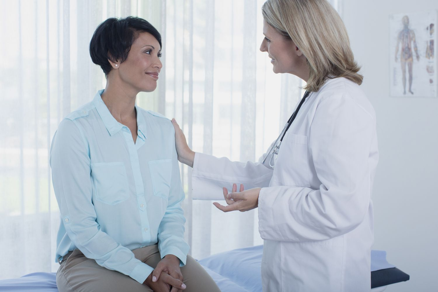 A doctor meets with a patient.
