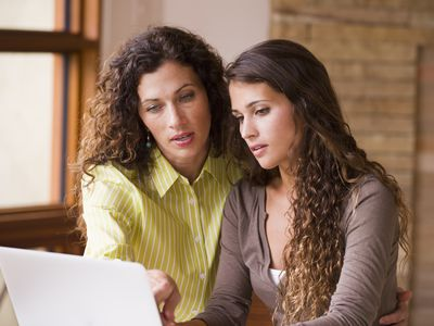 Mother and daughter filling out financial aid form online