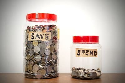 Two jars marked save and spend