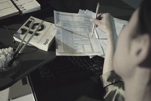 woman working on a tax form