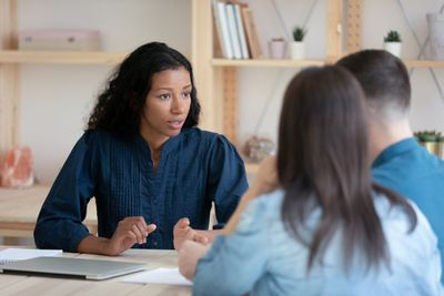 Young person consulting young couple at office meeting