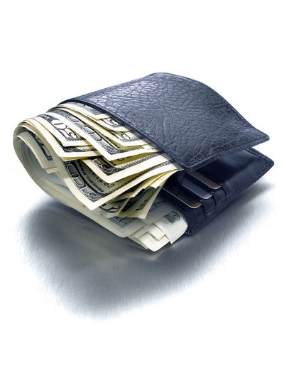 A wallet fat with money and credit cards from a high compensation job