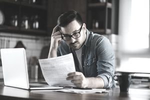 Portrait of a young man checking home finances