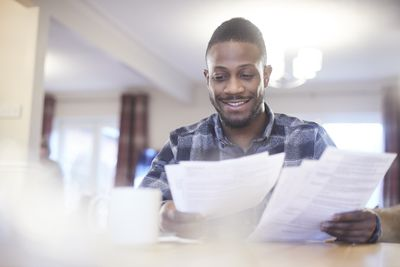 A smiling taxpayer reviews his tax return
