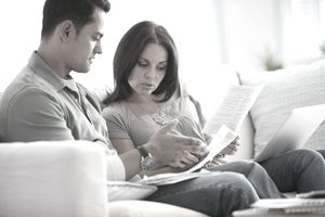 A couple looking at mortgage papers