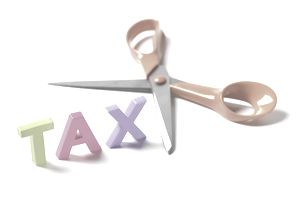 The word tax with scissors