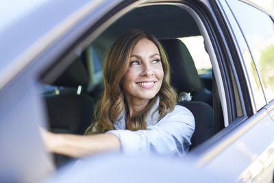 A woman gets ready for a quick trip across town in a rental car.