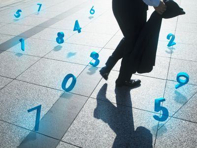 businessman walking surrounded by financial numbers