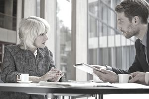 businessman and woman having serious conversation